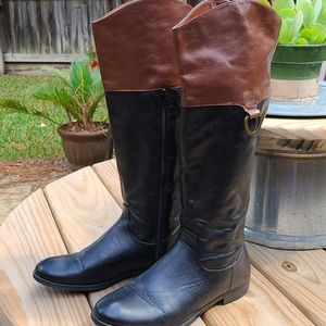 Black and tan faux leather boots